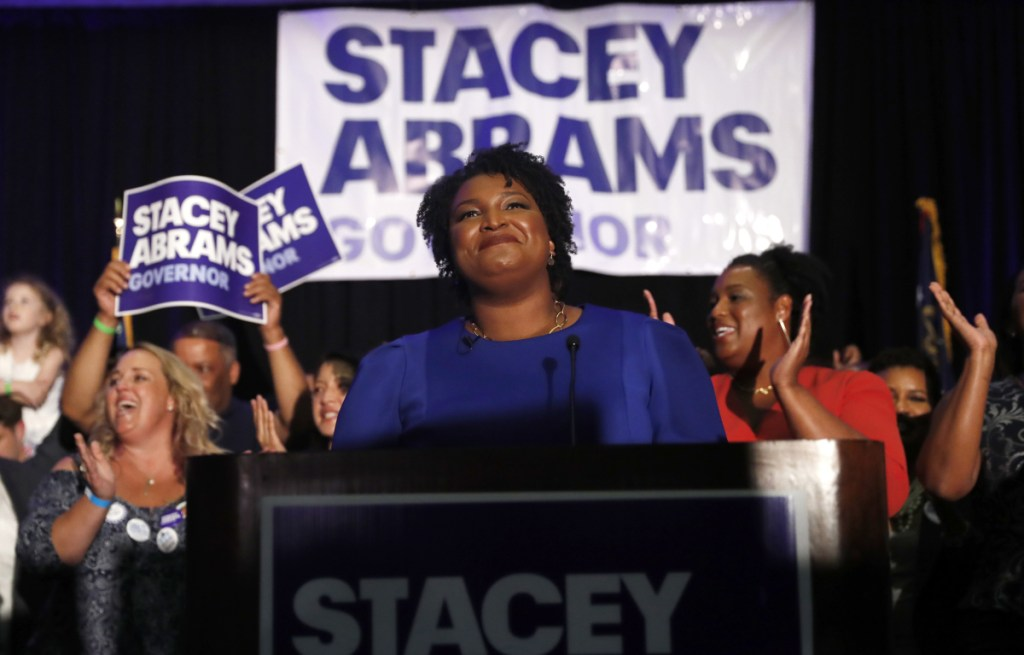 Georgia Democratic gubernatorial candidate Stacey Abrams faces her supporters on election night in Atlanta. More women than ever before have won their primaries.