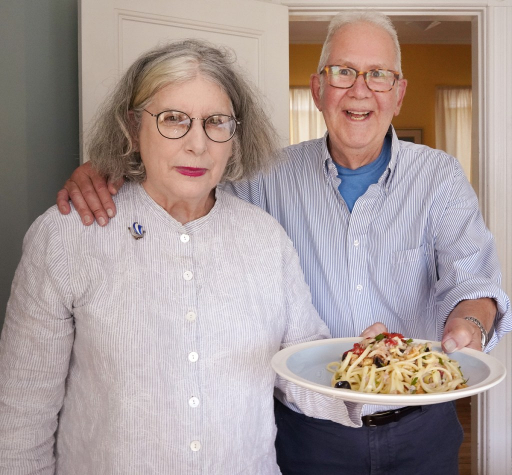 """Peter and Terry Weyl with a plate of Marco Polo Spaghetti at their Portland home on Monday. """"Tuna? Swiss cheese? Not what you might expect, but darned tasty,"""" Terry Weyl says of the dish."""