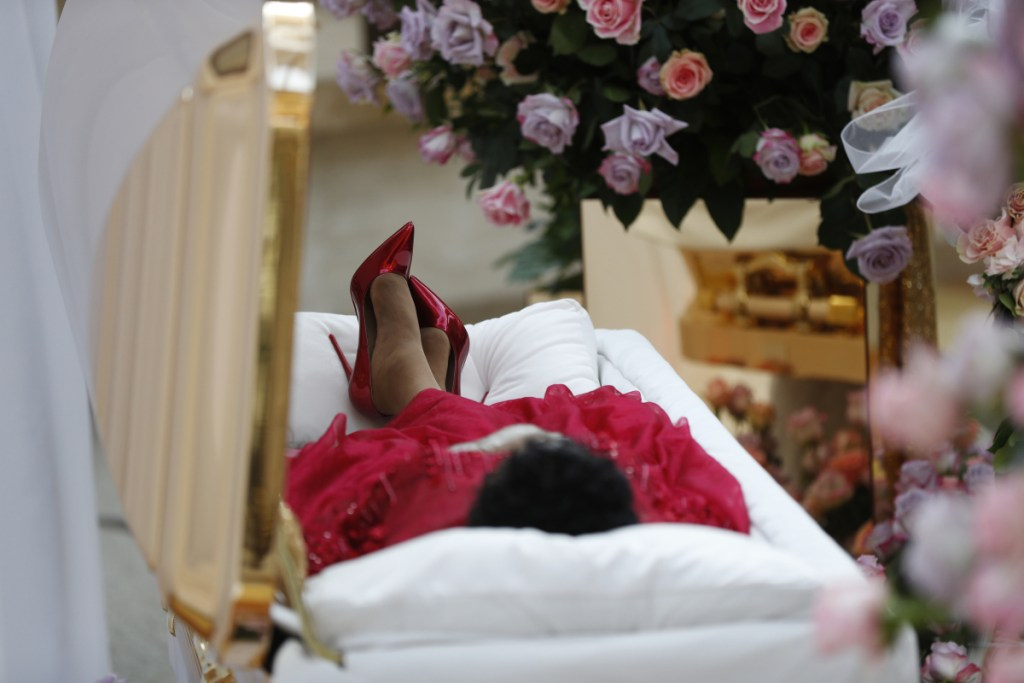 Aretha Franklin lies in her casket at Charles H. Wright Museum of African American History during a public visitation in Detroit on Tuesday. Franklin died Aug. 16 of pancreatic cancer at the age of 76.