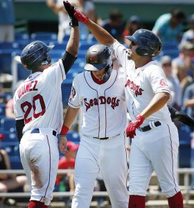 SEA DOG LUKE TENDLER, right, celebrates a two-run homer in the four th inning with Jhon Nunez, left, and Tate Matheny in the first game of Thursday's Eastern League doubleheader at Hadlock Field. The Sea Dogs swept the twinbill against Erie. DEREK DAVIS / PORTLAND PRESS HERALD