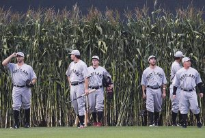 MEMBERS OF THE Portland Sea Dogs enter Hadlock Field through cornstalks while wearing throwback uniforms as part of their annual Field of Dreams game Wednesday. It was the next-tolast home game of the season for the Sea Dogs, who won 10-9 over New Hampshire. SHAWN PATRICK OUELLETTE / PORTLAND PRESS HERALD