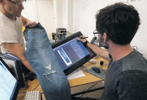 BART SIGHTS, head of the Eureka Lab, left, and Aykut Aygun, manager of technical innovation, give a demonstration on designing jeans at Levi's innovation lab in San Francisco. The process of making and selling an item of clothing is speeding up, as shoppers want products faster and faster in the age of Amazon. THE ASSOCIATED PRESS