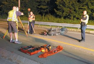 A BOWDOINHAM MAN was taken to Maine Medical Center Wednesday night with lifethreatening injuries following a motorcycle crash in Topsham, according to police. The crash was reported just after 9:30 p.m. near the intersection of Elm Street and Foreside Road. Topsham Police Sgt. Mark Gilliam said the motorcyclist was traveling on Elm Street toward the intersection, crossed the median and crashed the Harley Davidson. A passerby found him in the roadway and called for help. Gilliam said the 54-year-old man was not wearing a helmet. Topsham police are not releasing the victim's name until his family is notified. The crash remains under investigation. DARCIE MOORE / THE TIMES RECORD