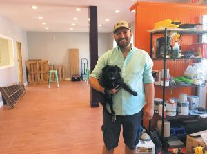 SAM WILSON AND HIS DOG GIR at Black Pug Brewing at 30 Bath Road in Brunswick. Wilson and a business partner hope to have the brewery open by October. THE FORECASTER PHOTO