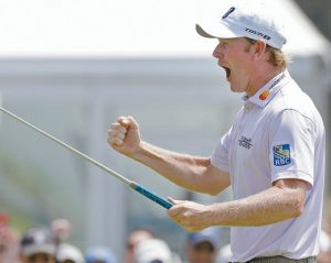 BRANDT SNEDEKER reacts after making a birdie putt on the ninth hole during the first round of the Wyndham Championship golf tournament in Greensboro, N.C., on Thursday. THE ASSOCIATED PRESS
