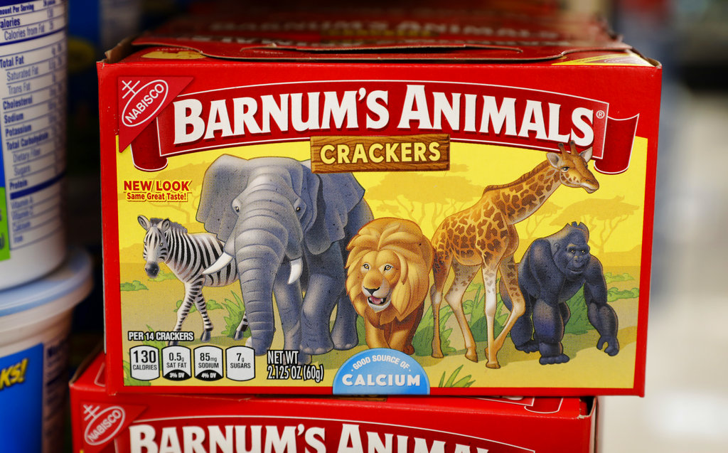"After more than a century behind bars, the animals on boxes of animal crackers are roaming free. The new boxes retain their familiar red and yellow coloring and prominent ""Barnum's Animals"" lettering. But instead of showing the animals in cages, implying that they're traveling in boxcars for the circus, the new boxes feature a zebra, elephant, lion, giraffe and gorilla wandering side-by-side in a grassland."
