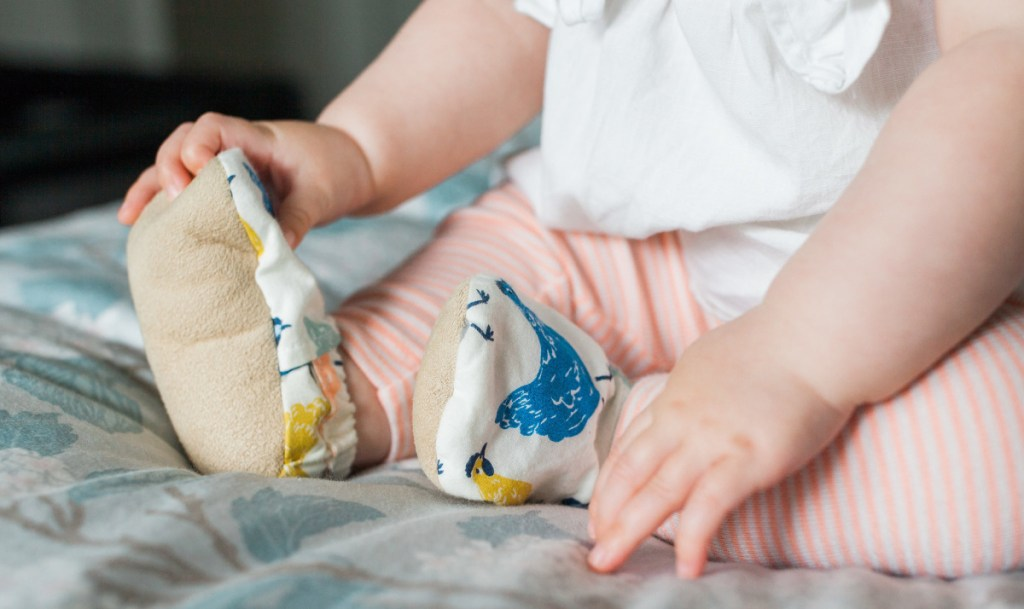 The booties have elastic around the ankle that makes them easy to get on a wiggly baby.