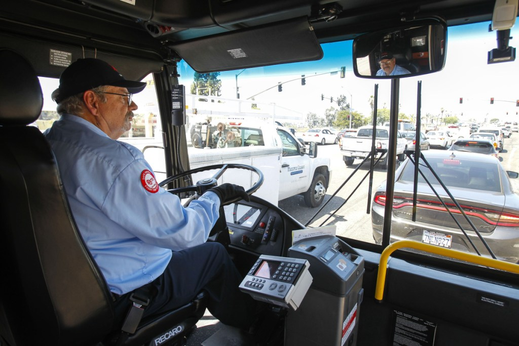 After Tom Middleton lost his job as a software engineer, he had difficulty finding a tech job despite his advanced degree. He's now employed as a bus driver for less than half the pay.