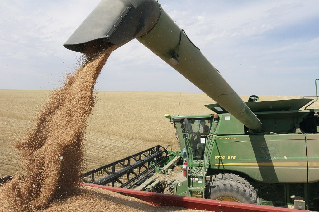 Wheat harvest near Patterson, Wash. in 2012.The trade war with China is making life difficult for many farmers across Washington state. Washington State stands to lose $480 million in agricultural exports to China because of retaliatory tariffs, according to the state Department of Agriculture.