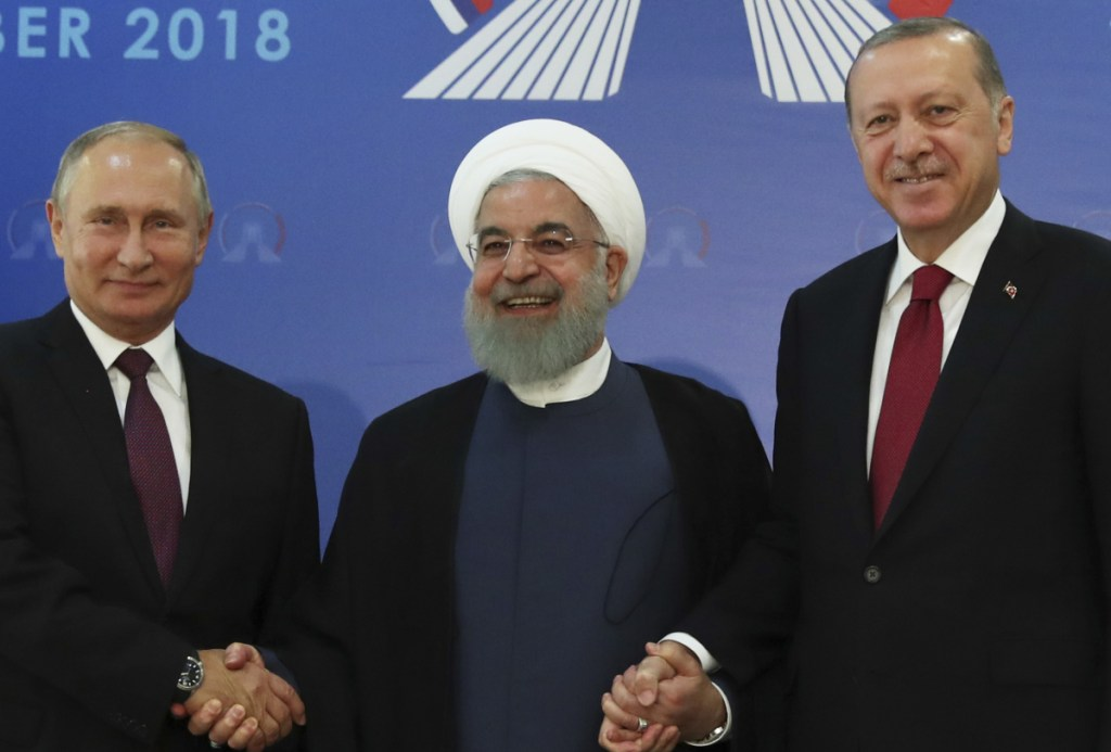 Iran's President Hassan Rouhani, center, flanked by Russia's President Vladimir Putin, left, and Turkey's President Recep Tayyip Erdogan, meet in Tehran ahead of their summit on Syria.