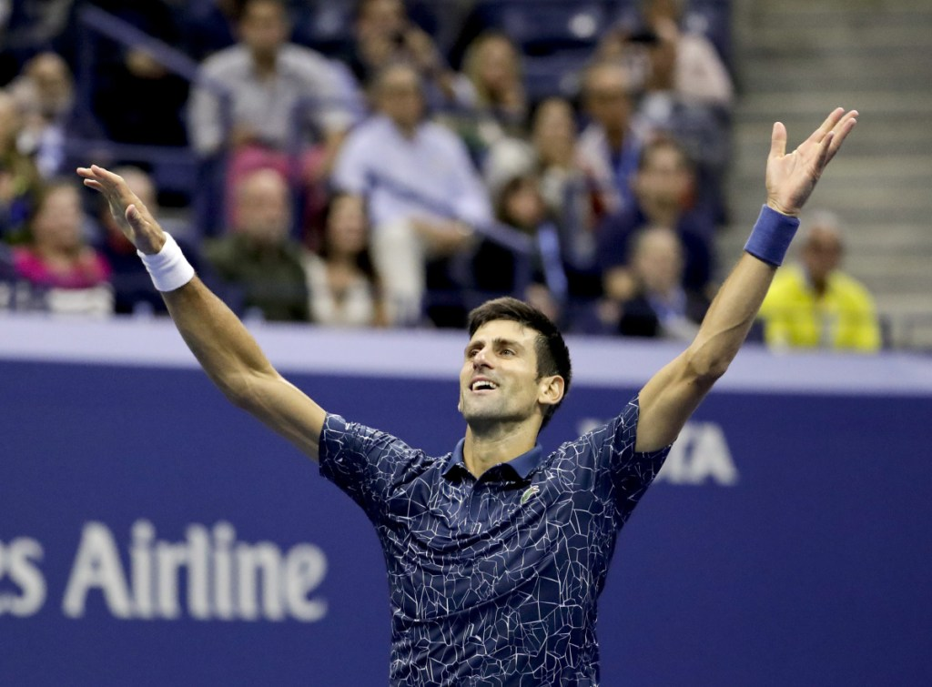 Novak Djokovic celebrates after defeating Juan Martin del Potro to win the U.S. Open men's title, 6-3, 7-6 (4), 6-3, on Sunday in New York.
