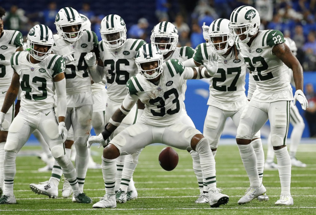 New York Jets defensive back Jamal Adams (33) celebrates his interception with teammates during the second half against the Lions in Detroit on Monday night. The Jets won 48-17.(AP Photo/Rick Osentoski)