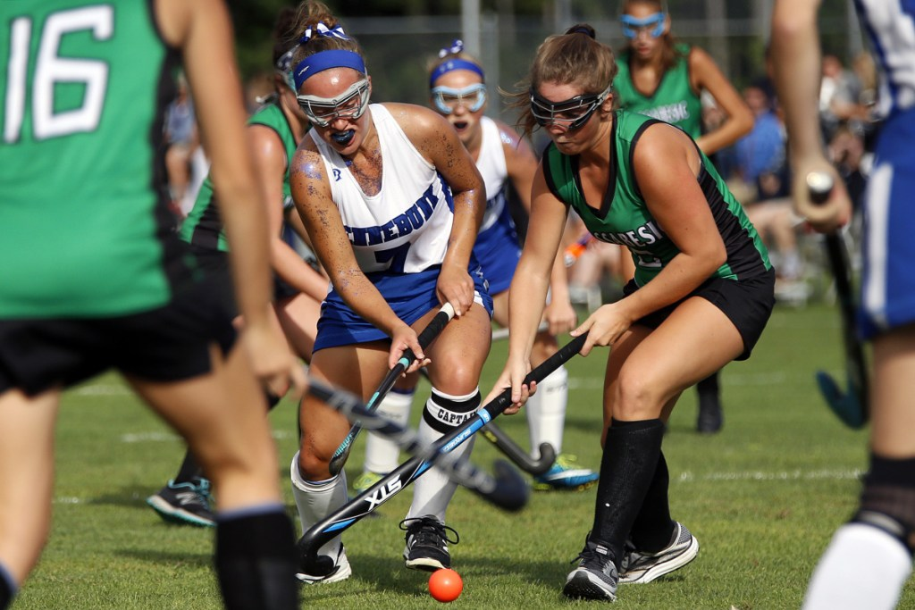 Kennebunk's Christine Jarowicz drives toward the goal with Massabesic's Marissa Thyng applying pressure in Tuesday's field hockey game at Kennebunk. The Rams won 3-2.
