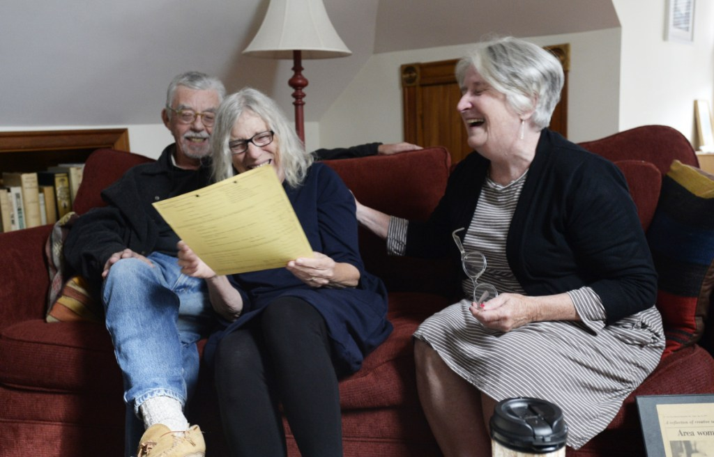 Jim and Agnes Bushell, with Marcia Brown, chuckle over old correspondence from what is now the Maine Arts Commission as they reminisce about their long-ago Portland press, Littoral Books.