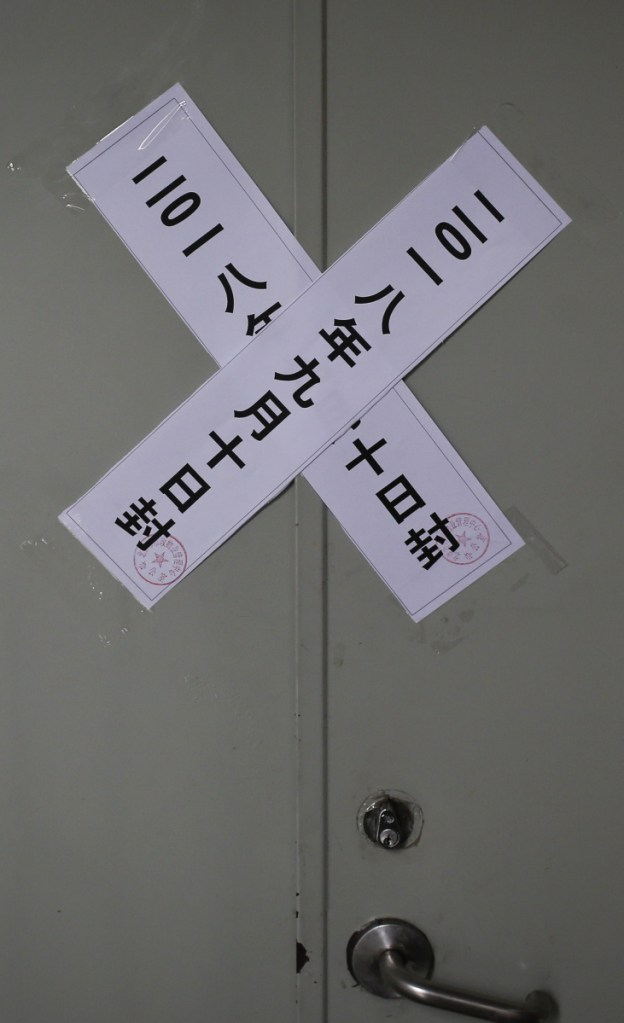 Official seal notices are stuck on a backdoor entrance of the Zion Church after it was shut down by authorities in Beijing.