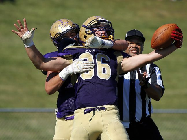 Teigan Lindstedt celebrates the go-ahead touchdown with Cheverus teammate Vick Marrone during a 19-13 win over Lewiston.
