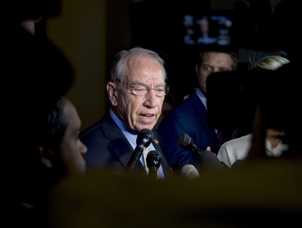 Senate Judiciary Committee Chairman Chuck Grassley, R-Iowa, speaks to reporters on Capitol Hill on Wednesday. On Friday night, he gave Christine Blasey Ford a 10 p.m. deadline to decide whether to testify on her sexual assault allegation against Supreme Court nominee Brett Kavanaugh. Shortly before midnight, he extended that deadline.