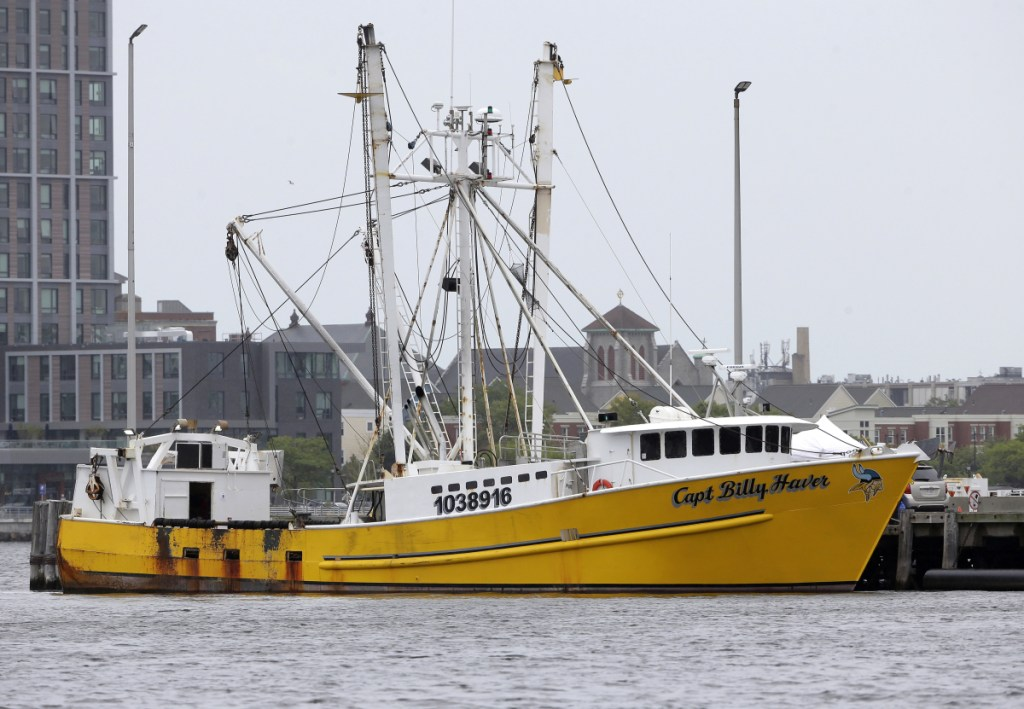 The Virginia-based fishing vessel Captain Billy Haver is docked Tuesday at the U.S. Coast Guard Station in Boston. A crew member was charged with murder and attempted murder in connection with an attack Sundayon the fishing vessel while it was underway about 55 miles off Nantucket, Massachusetts.