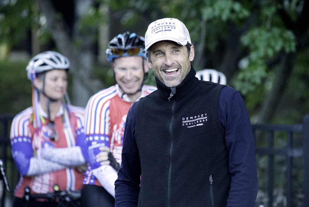 Patrick Dempsey meets cyclists from South Carolina at Bonney Park in Auburn on Friday evening. Fifteen cyclists rode 1,300 miles from Greenville, S.C., to participate in their sixth Dempsey Challenge. Running, walking and biking events take place Saturday and Sunday.