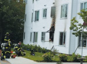 FIREFIGHTERS AND A SPRINKLER SYSTEM stopped a fire at 47 Floral St. in Bath on Sunday morning. A group of elderly residents at Seacliff Apartments escaped safely after fire broke out inside one of the building's 36 units. DARCIE MOORE / THE TIMES RECORD