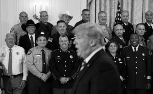 SHERIFFS LISTEN as President Donald Trump responds to a reporters question during an event in the East Room of the White House in Washington on Wednesday. AP PHOTO / SUSAN WALSH