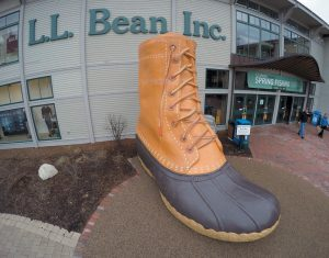 SHOPPERS exit the L.L. Bean retail store in Freeport in this 2016 photo. The company is offering a free charging station for electric vehicles — the largest in Maine. AP PHOTO/ROBERT F. BUKATY, FILE