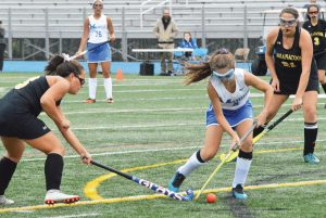 MORSE FORWARD Kennedy St. Pierre prepares to fire a shot between Maranacook defenders Emma Wadsworth (13) and Amanda Goucher (21) during a KVAC field hockey game at Bath on Monday. The Shipbuilders rolled to a 4-1 victory. BOB CONN / THE TIMES RECORD