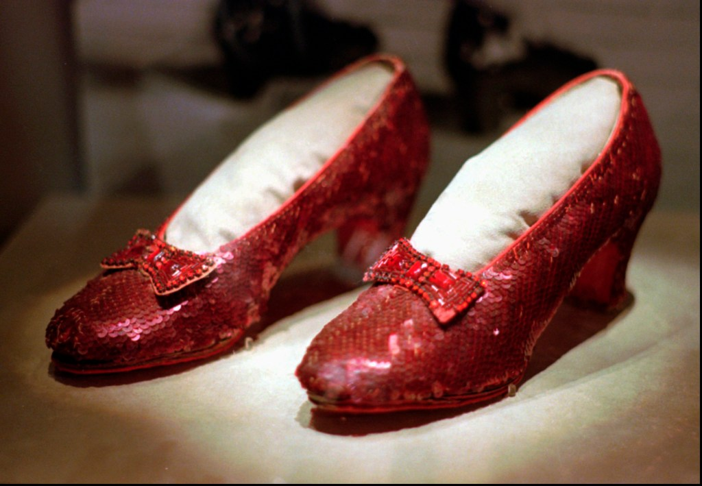 "This April 10, 1996, file photo shows one of the four pairs of ruby slippers worn by Judy Garland in the 1939 film ""The Wizard of Oz"" on display during a media tour of the ""America's Smithsonian"" traveling exhibition in Kansas City, Mo. Federal authorities say they have recovered a pair of ruby slippers worn by Garland that were stolen from the Judy Garland Museum in Grand Rapids, Minn., in August 2005 when someone went through a window and broke into the small display case. The shoes were insured for $1 million."