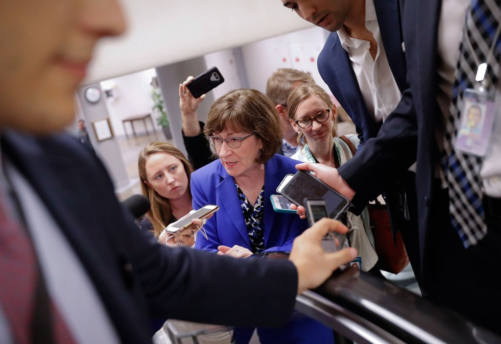 "Sen. Susan Collins, R-Maine, speaks to members of the media as she walks to the Senate floor on Capitol Hill in Washington on Monday. When asked about sexual assault allegations against Supreme Court nominee Brett Kavanaugh by a California professor, Collins told reporters that ""to be fair to both sides"" there needs to be a hearing."