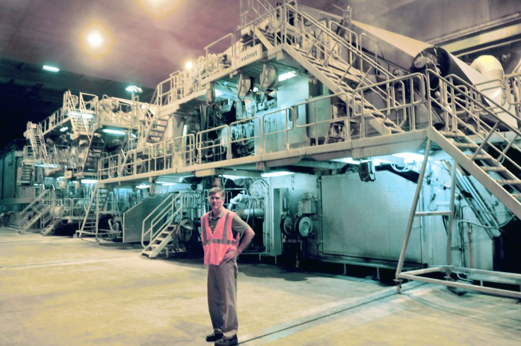 Russ Drechsel, president and CEO of UPM Madison, stops before the mill's giant paper-making machine during a tour of the company in Madison on Aug. 20, 2015. The mill closed at the end of May 2016. The paper machine was sold in the summer of 2018 and is being moved to China.