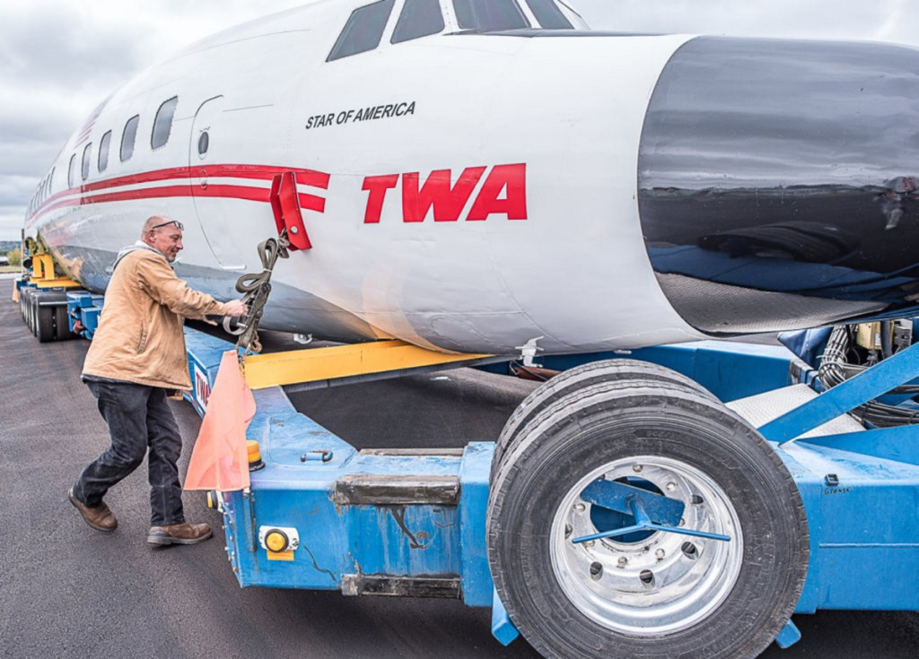 "Marty Batura of Worldwide Aircraft Recovery checks the rigging on the body of the ""Super Star"" aircraft, which will start the 328-mile journey to Queens at 7 a.m. Tuesday. ""There's going to be a lot of double-takes"" by onlookers, he said."