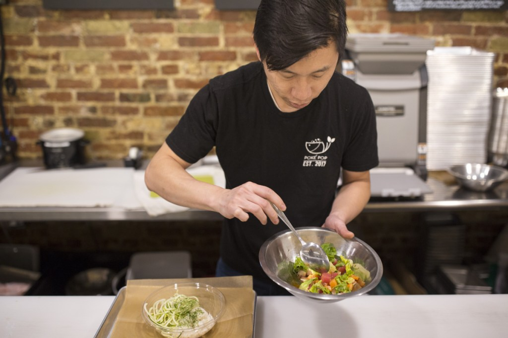 Anusat Limsitong, who also operates Thai 9 in Scarborough, opened his new restaurant in July. Here he prepares a chirashi poké bowl.
