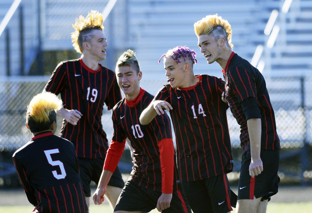 Scarborough players Marcus McKeough, Daniel Travers, Elliot Dumais, Brian Farino and Liam Bridgham, from left to right, celebrate a goal by Bridgham in a 2-0 win over Thornton Academy during a Class A South boys' soccer prelim Friday afternoon.
