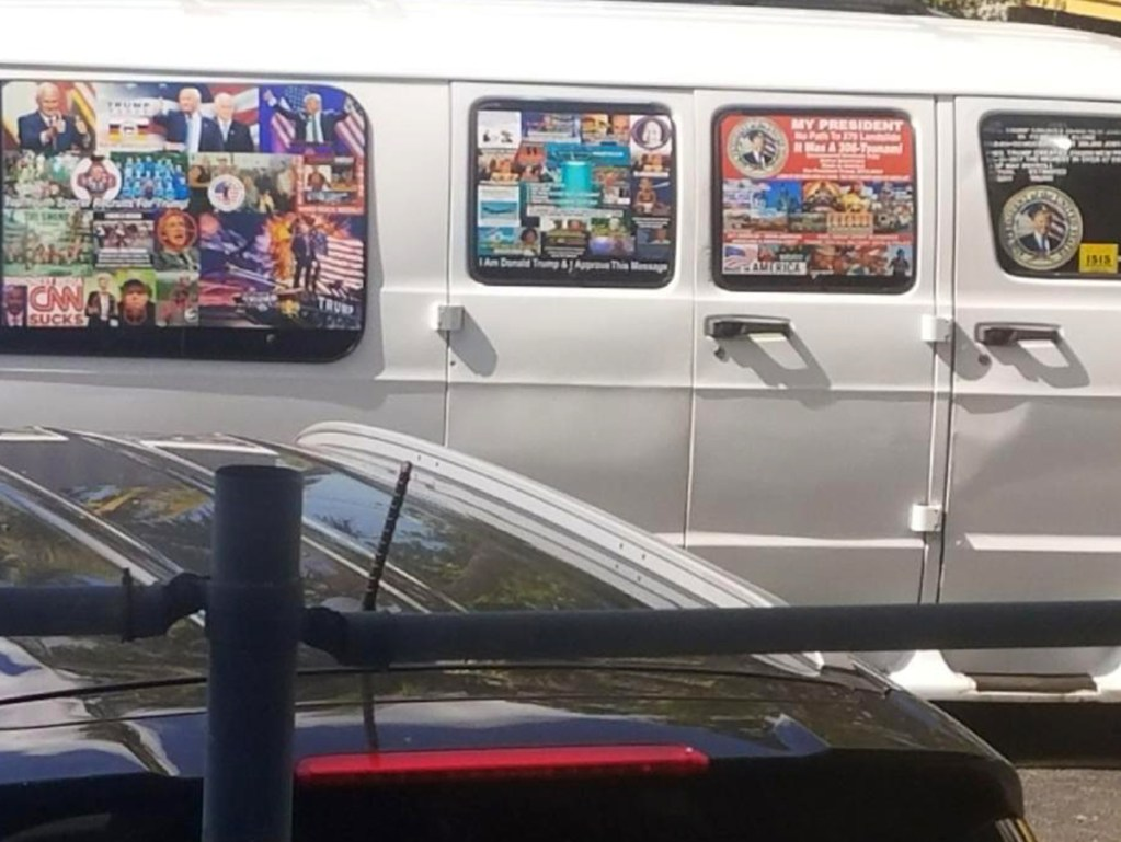 Photo shows a van with windows covered with an assortment of stickers in Well, Fla. Federal authorities took Cesar Sayoc, above, into custody on Friday.