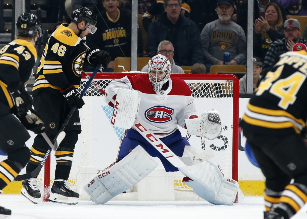 Canadiens goaltender Carey Price makes a save with David Krejci of the Bruins on the doorstep during Montreal's 3-0 victory in Boston on Saturday night.