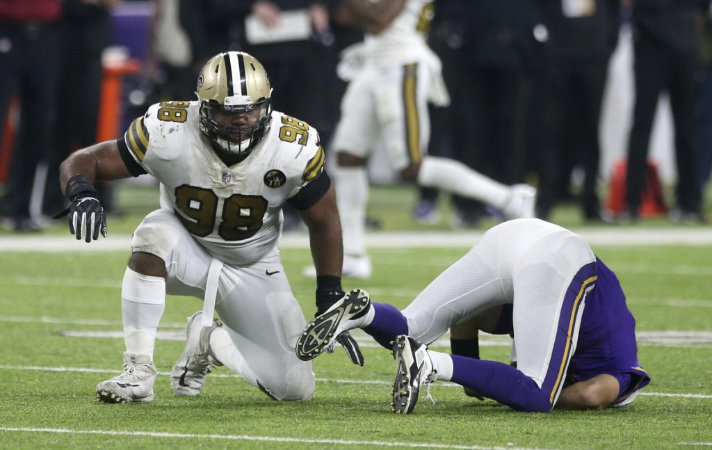 New Orleans defensive tackle Sheldon Rankinscelebrates after sacking Minnesota quarterback Kirk Cousins during the second half on Sunday night in Minneapolis.