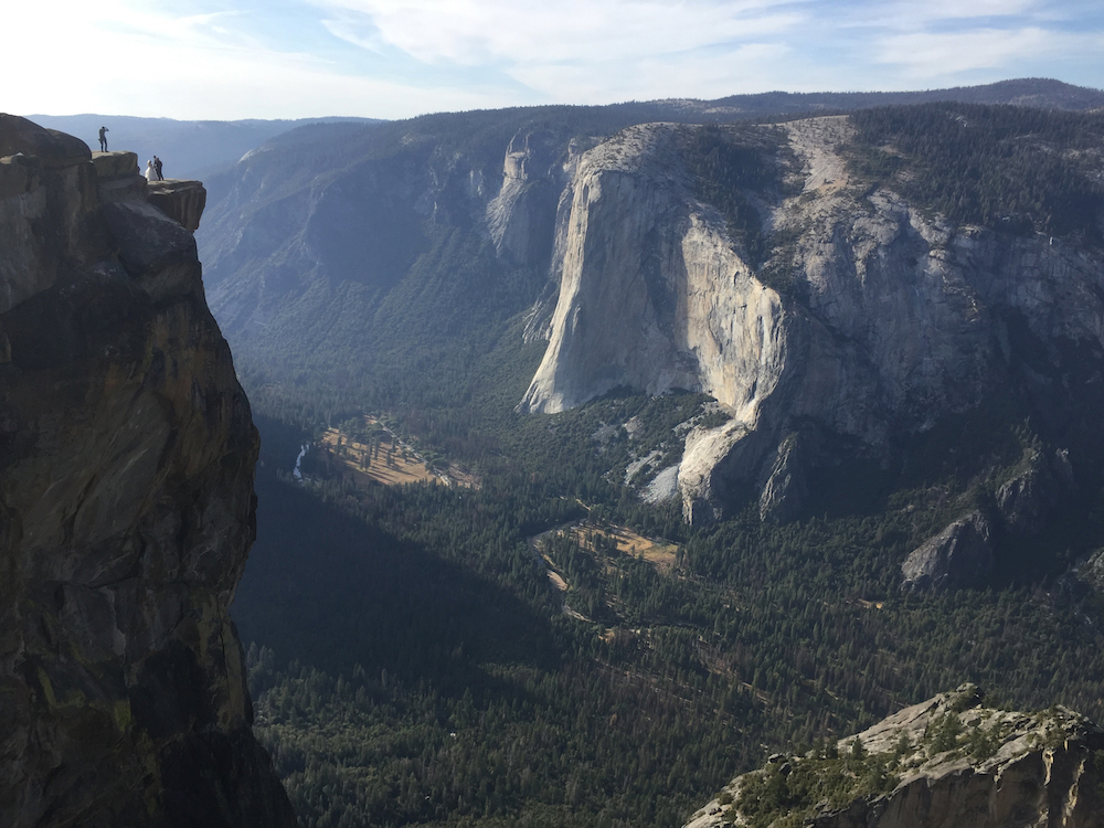 A wedding couple are seen being photographed at Taft Point in California's Yosemite National Park in September.