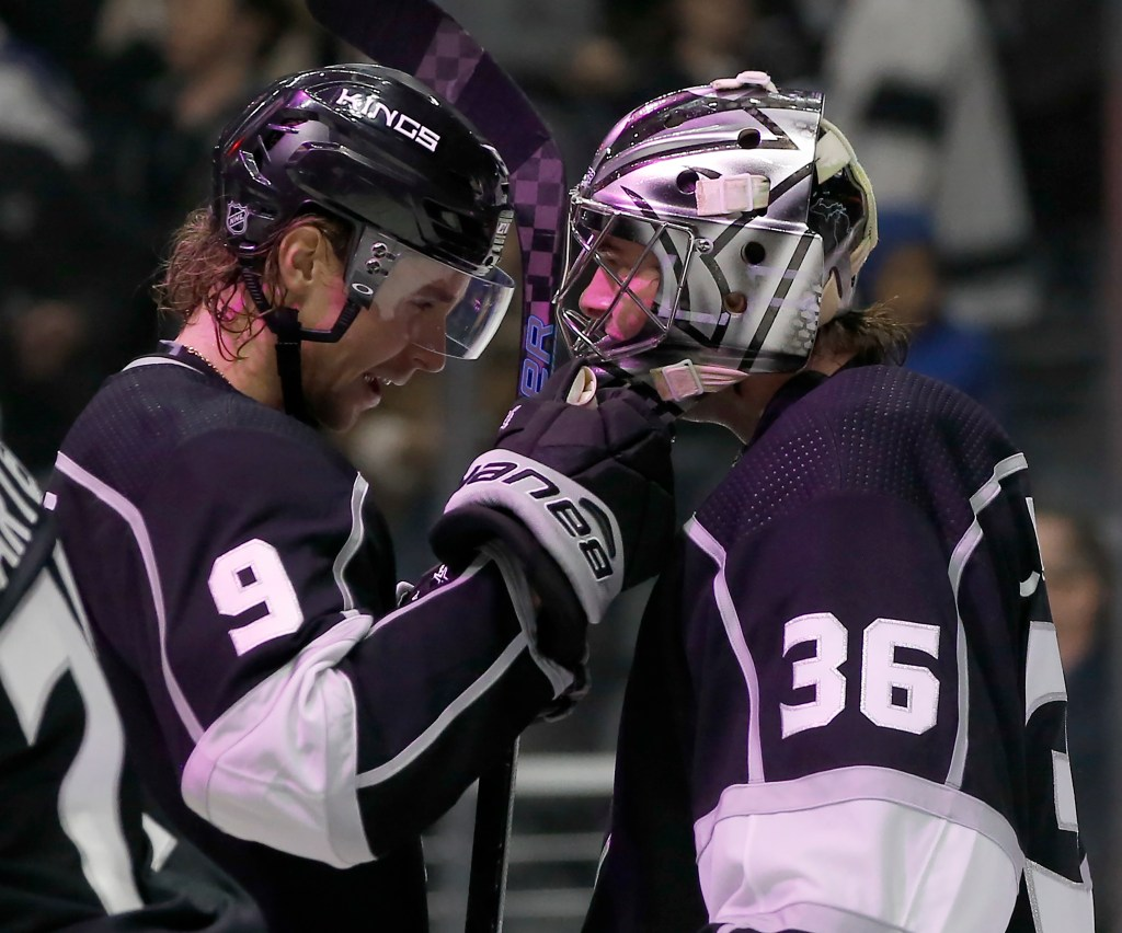 Los Angeles Kings goaltender Jack Campbell, right, celebrates with center Adrian Kempe after they defeated the New York Rangers on Sunday in Los Angeles.