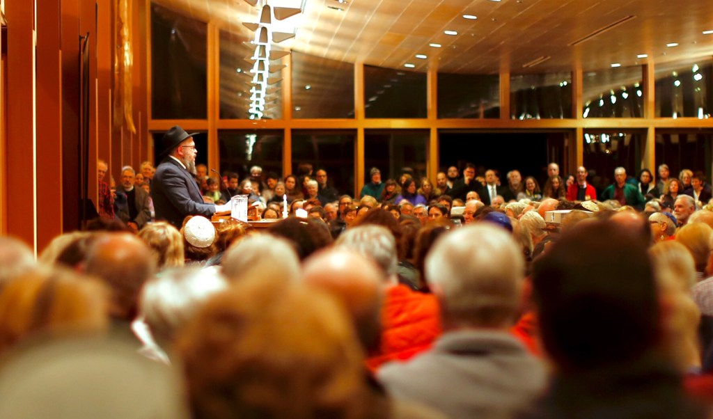 Rabbi Moshe Wilansky addresses an overflow crowd during a vigil at Congregation Bet Ha'am in South Portland on Oct. 30. The gathering was held to commemorate the 11 people killed at a Pittsburgh synagogue three days earlier. On Monday, the Portland City Council approved a resolution condemning hate and discrimination.
