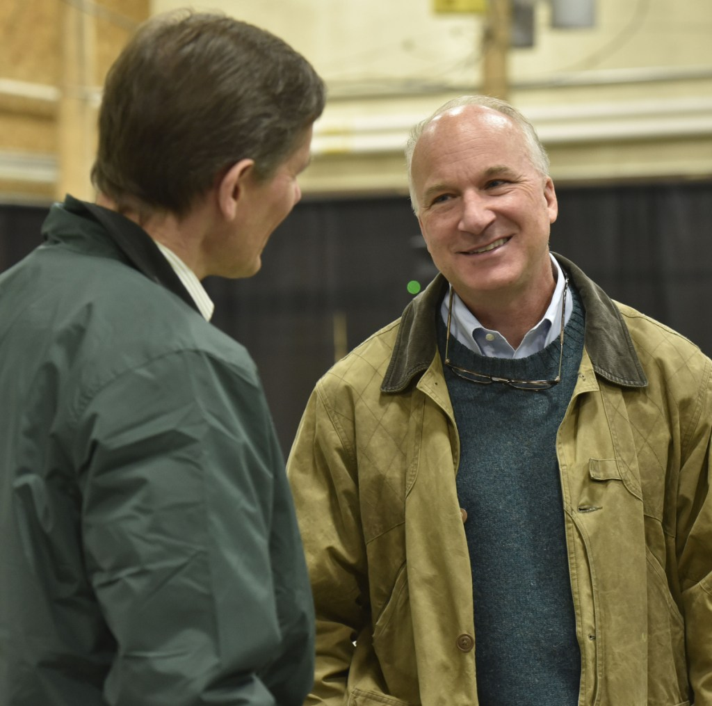 Derek Langhauser, right, president of the Maine Community College System, speaks with Robert Kump, of Avangrid Networks, during an open house Wednesday at Kennebec Valley Community College in Fairfield.