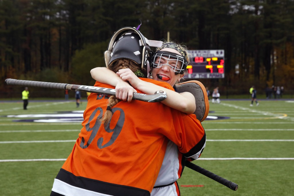 Gardiner High goalkeeper Lindsey Bell and teammate Amanda Cameron embrace after defeating York, 3-2, in the Class B state championship Saturday at Deering High School in Portland.