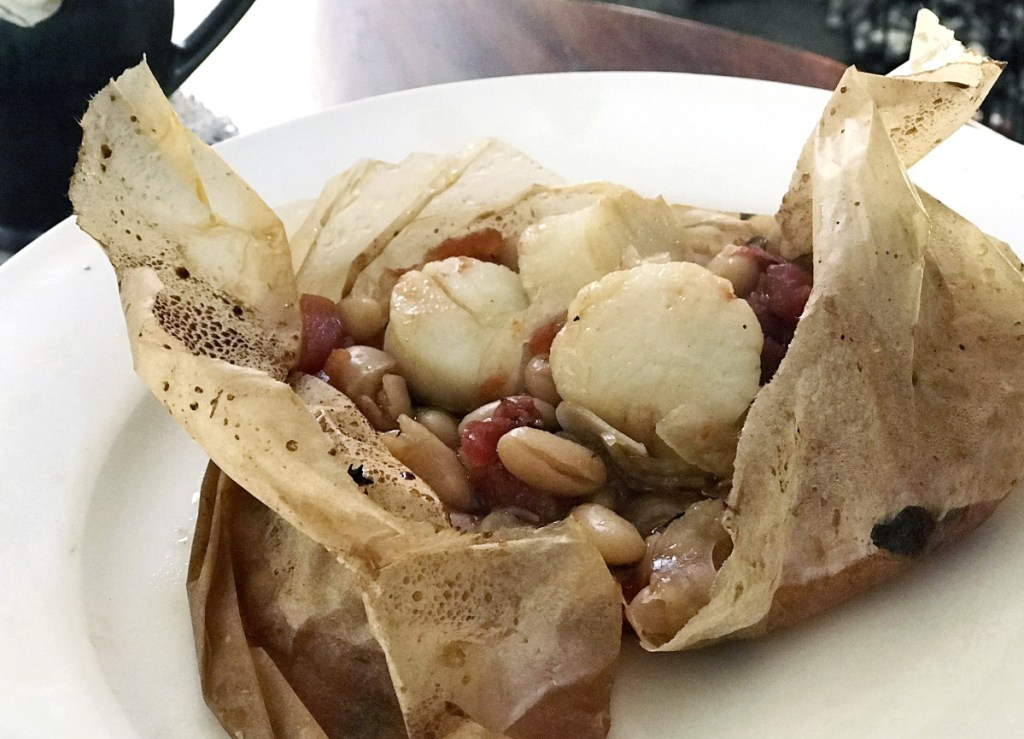 The scallops in this dish were frozen when popped into their parchment packets.