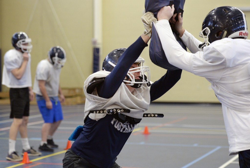 Linebacker Jack Campbell, center, runs a drill during practice Wednesday as Fryeburg Academy prepares for the Class C state championship game Saturday against Nokomis.