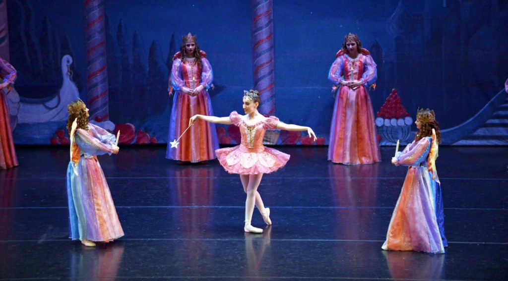 "Adrienne Pelletier in the Maine State Ballet production of ""The Nutcracker."" Pelletier is sharing the role of the Sugar Plum Fairy with her sister Rhiannon."