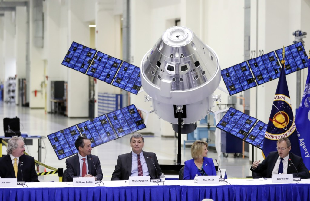 The European Space Agency's director general, Jan Worner, far right, answers questions Friday during a panel discussion with U.S. and European leaders at the Kennedy Space Center in Cape Canaveral, Fla. Behind them is a model of the Orion capsule and the service module.