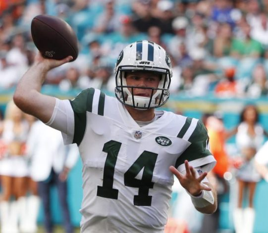 New York Jets quarterback Sam Darnold says his right foot is pain-free, but he remains out of practice.