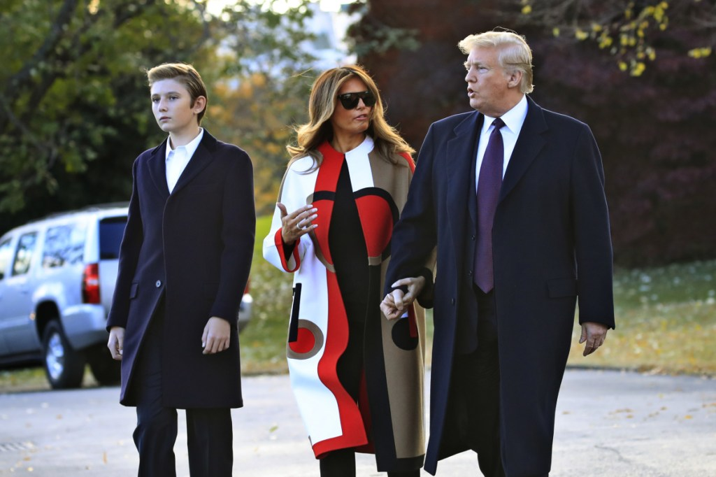 President Trump, first lady Melania Trump and their son Barron Trump walk across the South Lawn of the White House on Tuesday to board the Marine One. The family is traveling to Florida, where they will spend Thanksgiving at Mar-a-Lago.