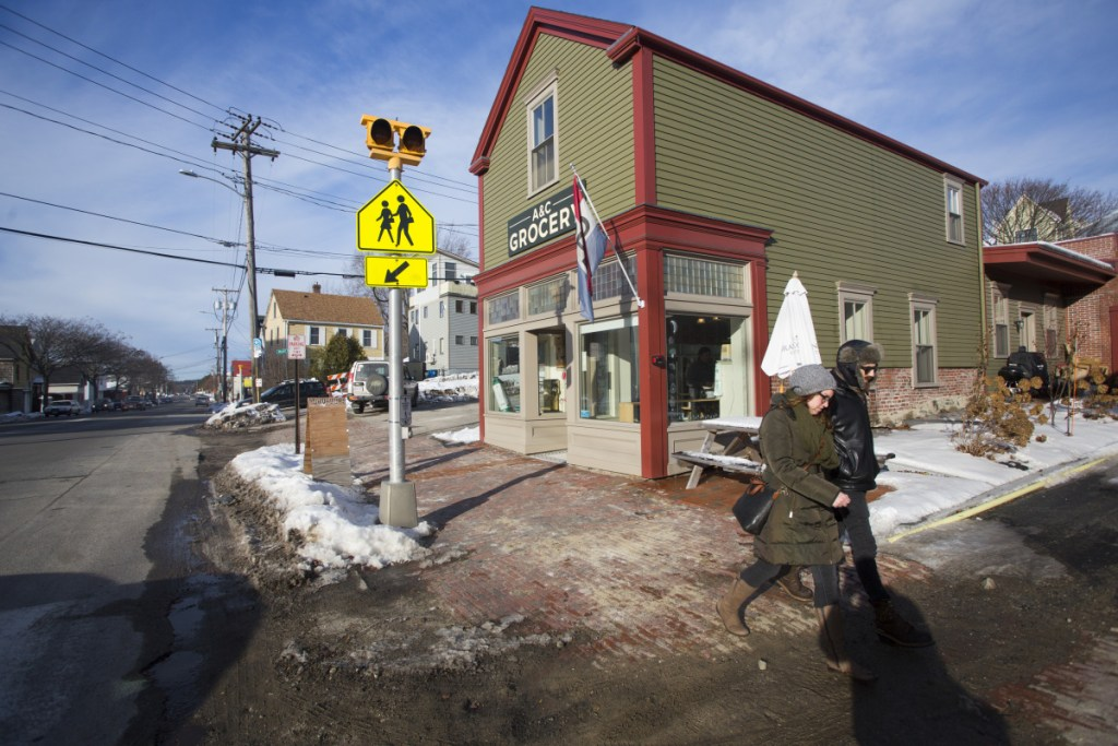 """Businesses along Washington Avenue, including A&C Grocery, have been affected by water and sewer line work that has torn up the road and sidewalk in front of the stores. Owner Joe Fournier: """"It's gone from an industrial corridor to a very cool and dynamic row of interesting, locally owned businesses."""""""