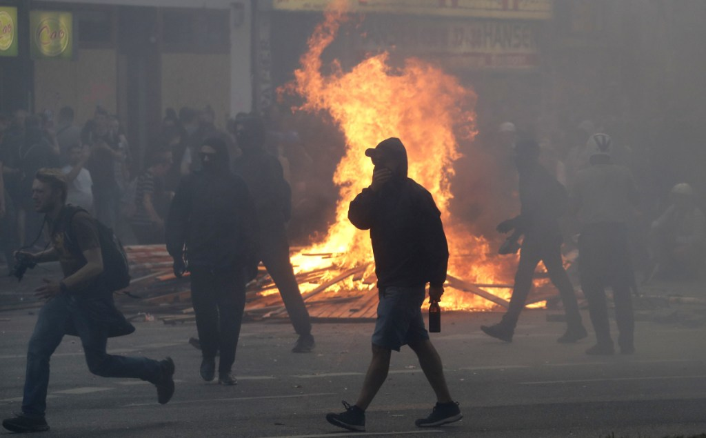 A fire burns on a street in Hamburg, Germany, last year as protesters confront police during a G-20 summit. Argentina is preparing for similar protests during a summit that begins Friday.