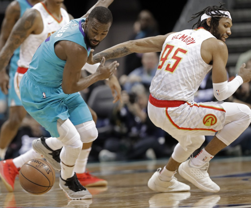 Charlotte's Kemba Walker, left, steals the ball from Atlanta's DeAndre' Bembry in the first half Wednesday night in Charlotte, N.C. The Hornets won, 108-94.